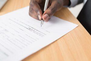 A man signing an agreement